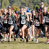 Runners leave the starting line at the beginning of the girls race at the IHSAA Cross Country Sectional at Pendleton Heights.