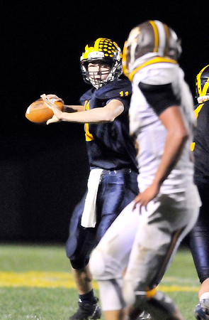 John P. Cleary    The Herald Bulletin<br /> Shenandoah's quarterback Peyton Starks lets go with a pass.