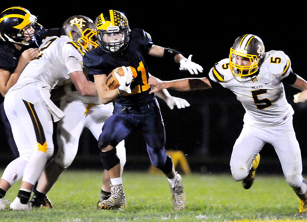 John P. Cleary    The Herald Bulletin<br /> Shenandoah's Joe Huff splits the Monroe Central defense for another big gain.