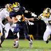 John P. Cleary |  The Herald Bulletin<br /> Shenandoah's Joe Huff splits the Monroe Central defense for another big gain.