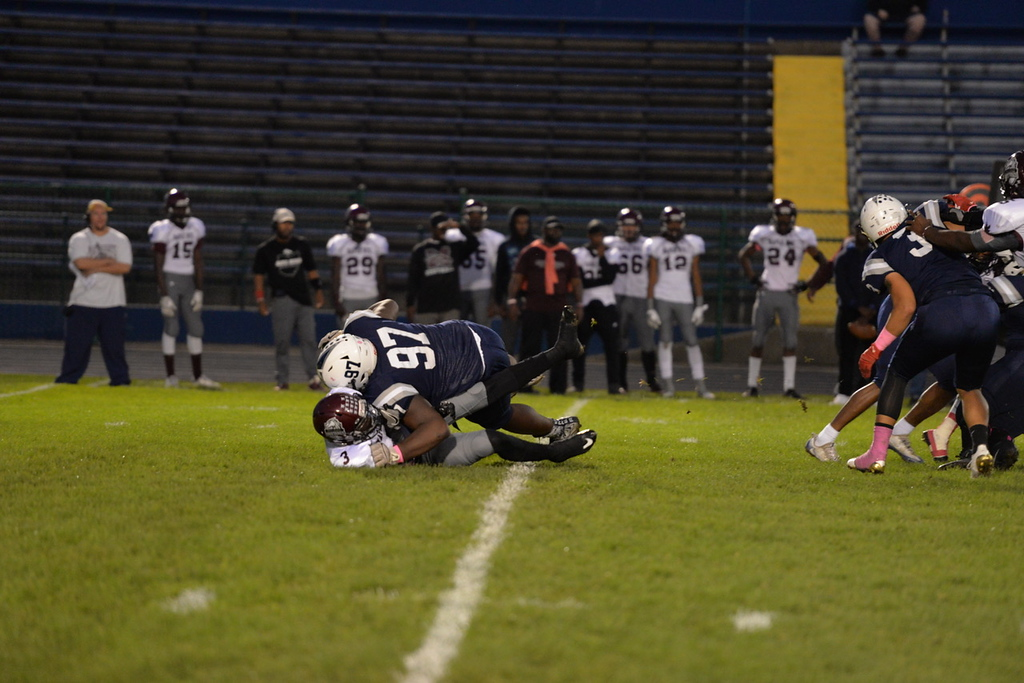. Aimee Bielozer - The Morning Journal<br> Lorain\'s Antonio Wyatt breaks through the line for a sack against Maple Heights on Oct. 13.