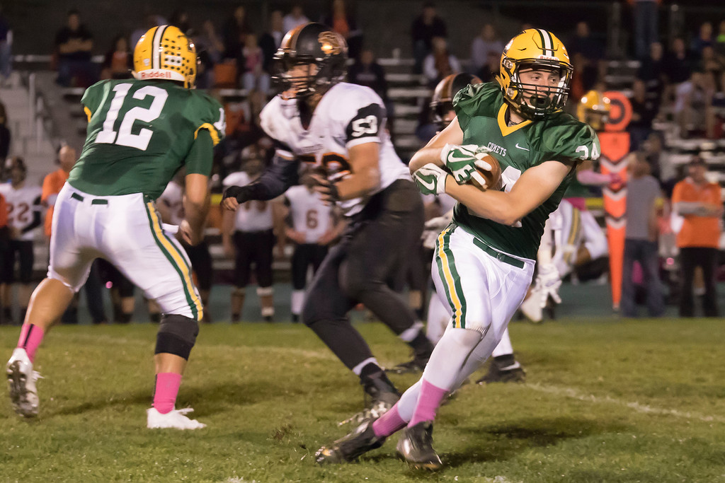 . Jen Forbus - The Morning Journal<br> Amherst running back Joey Tomaro (34) receives the hand off from quarterback Matt Fairchild (12) and turns up field against North Olmsted on Oct. 13.