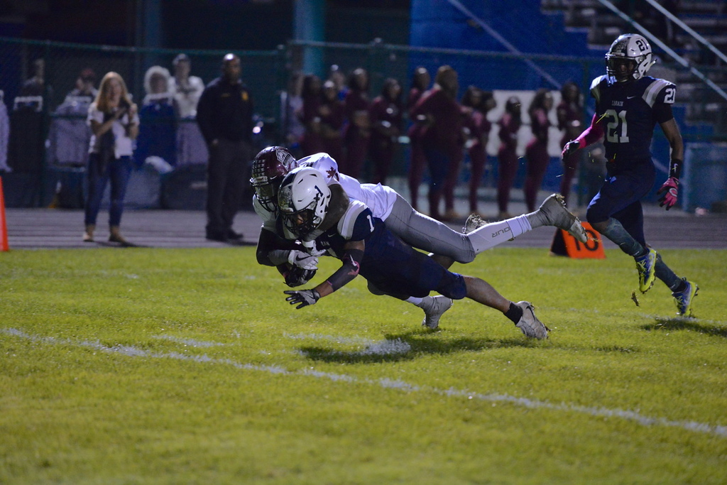 . Aimee Bielozer - The Morning Journal<br> Lorain\'s Tyshawn Lighty dives into the end zone for a touchdown against Maple Heights on Oct. 13.