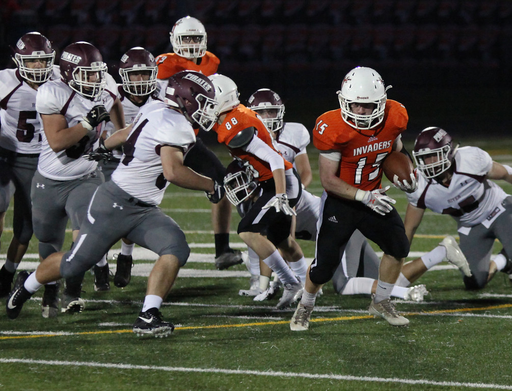 . Randy Meyers - The Morning Journal<br> Normandy\'s Neno Czerwinski is brought down by a group of Rocky River defenders after a short gain during the first quarter on Oct. 12.