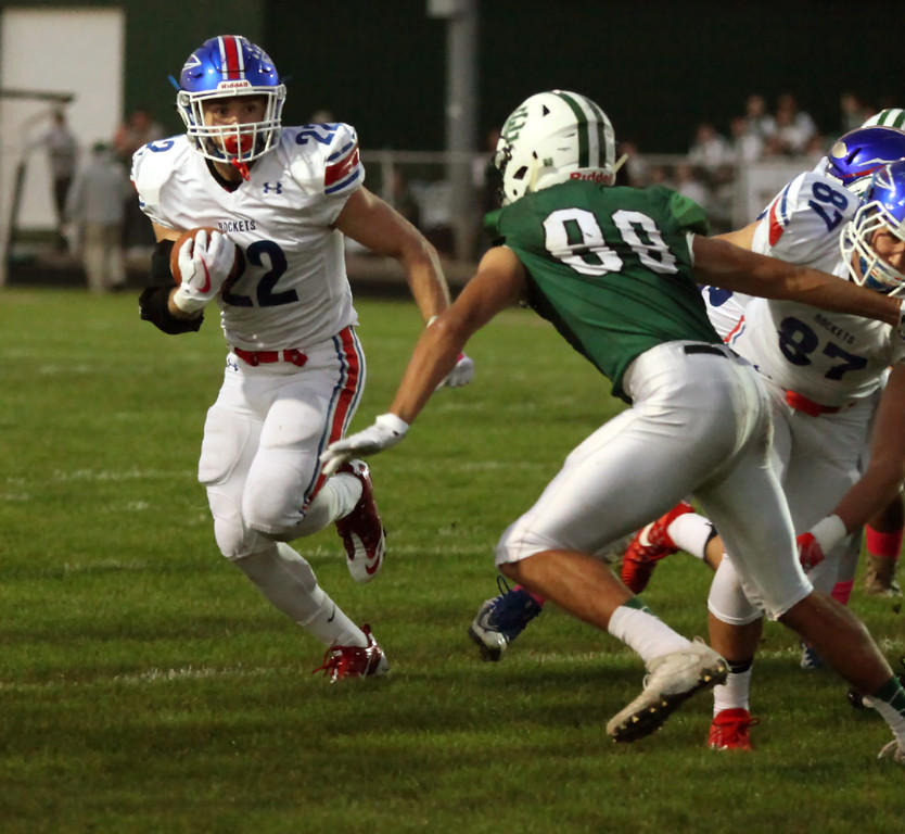 . Randy Meyers - The Morning Journal<br> Bay running back Trey Psota turns the corner on Thomas Horne of Elyria Catholic and scores the game\'s first touchdown during the first quarter on Oct. 13.