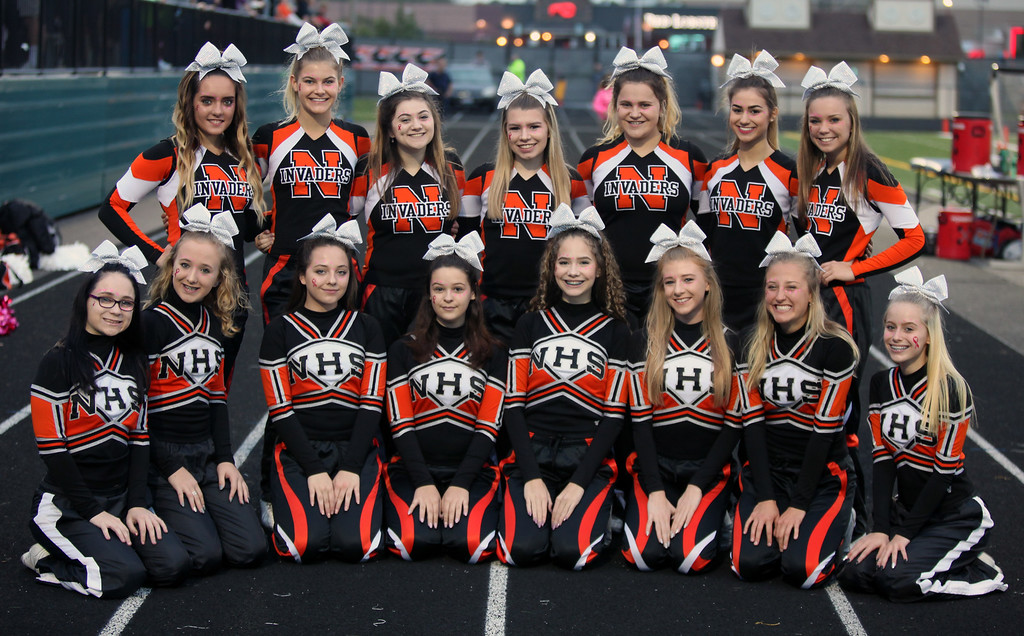 . Randy Meyers - The Morning Journal<br> The Normandy varsity and JV cheerleaders pose for a photo prior to Thursday\'s game against Rocky River.