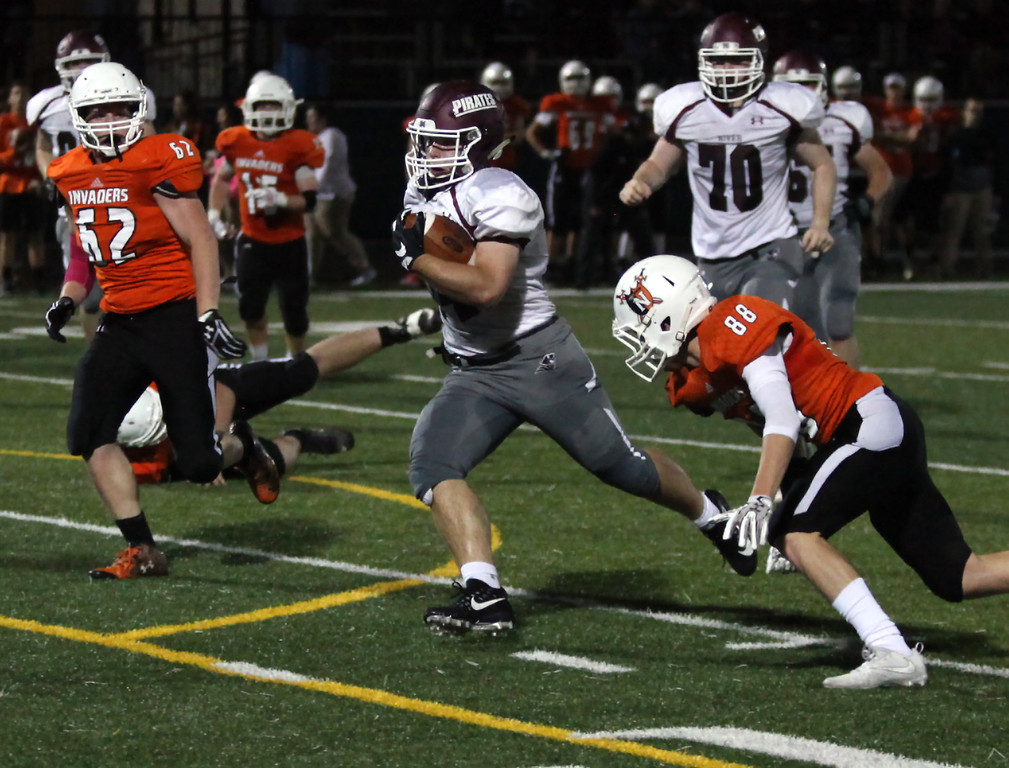. Randy Meyers - The Morning Journal<br> Matthew Popovich of Rocky River runs through the Normandy defense for a  touchdown during the second quarter on Oct. 12.