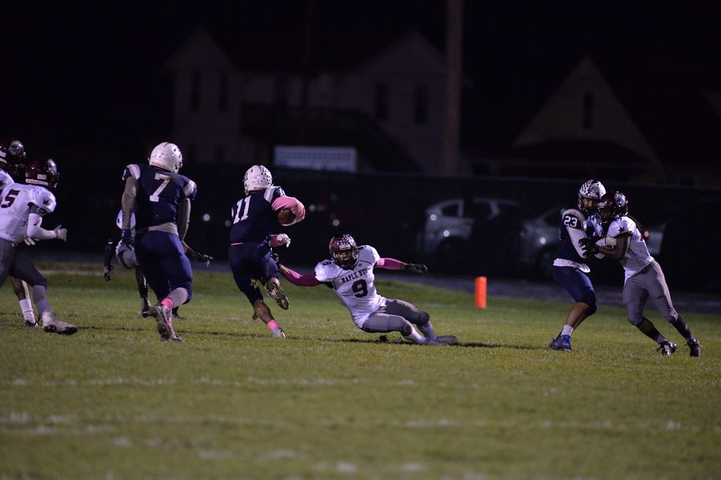 . Aimee Bielozer - The Morning Journal<br> Lorain\'s Daylin Dower rushes the ball against Maple Heights on Oct. 13.