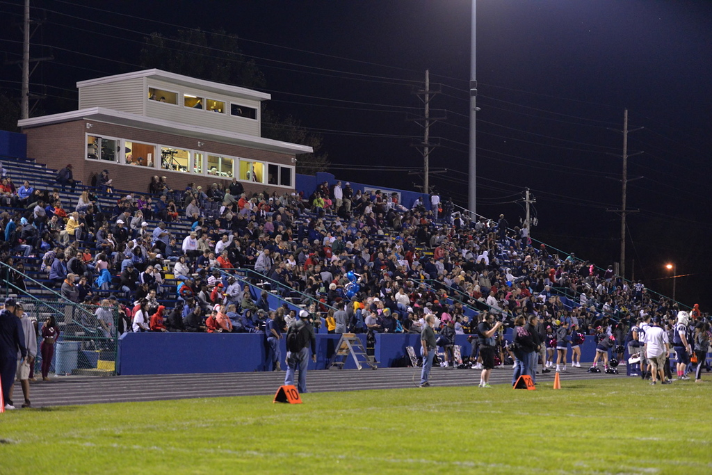 . Aimee Bielozer - The Morning Journal<br> The Lorain faithful watch as the Titans face Maple Heights on Oct. 13.