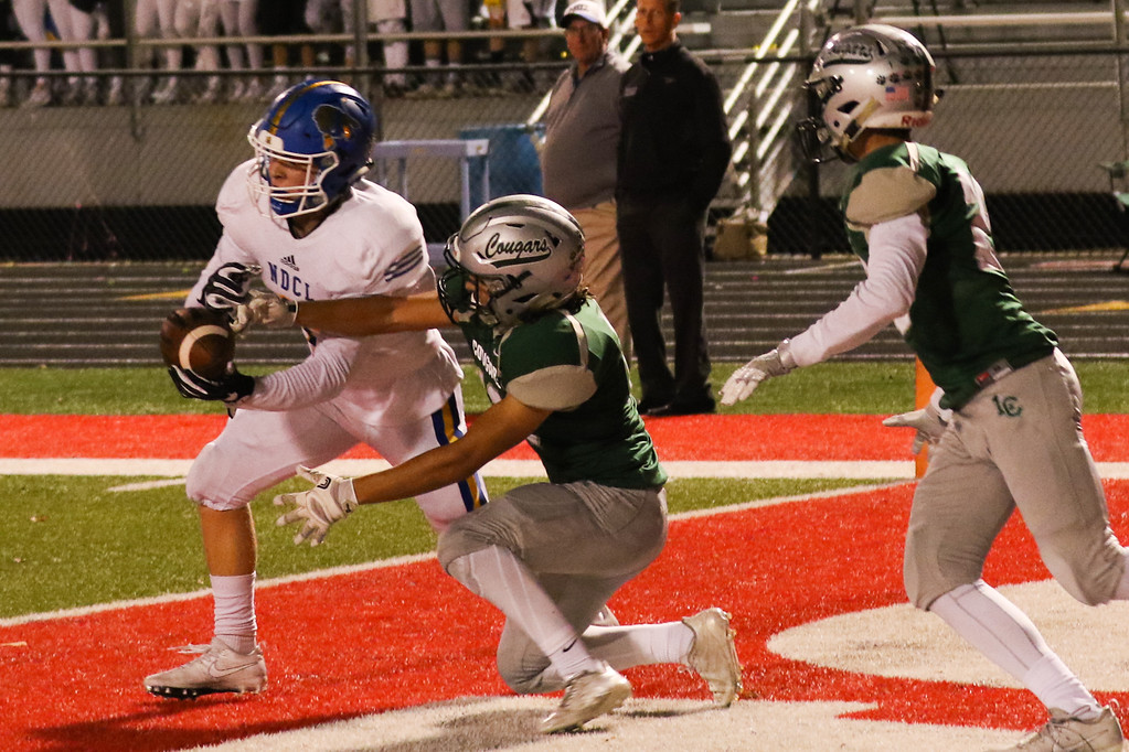 . 2017 - Football - NDCL at Lake Catholic.  NDCL defeated Lake Catholic 45-14.  NDCL receiver Matt Tuohey (2) steps in front of Lake Catholic\'s  Vincenzo Patriarca (13) to catch the pass for a TD in the 2nd quarter.