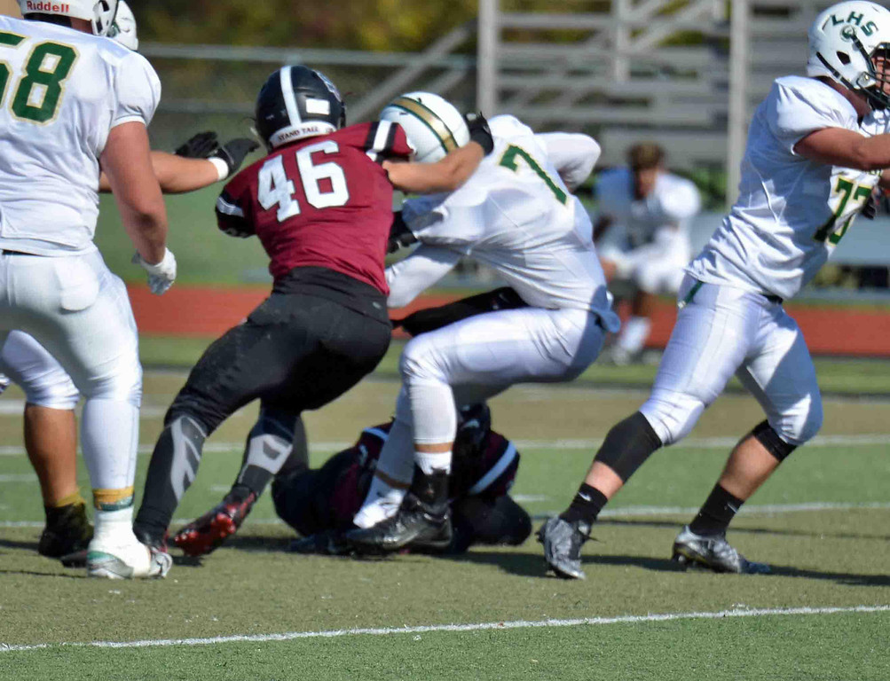 . Paul DiCicco - The News-Herald University linebackers Kevin Douglass and Dillon Loconti, sack the Lakeside quarterback in the second quarter on Oct 14.