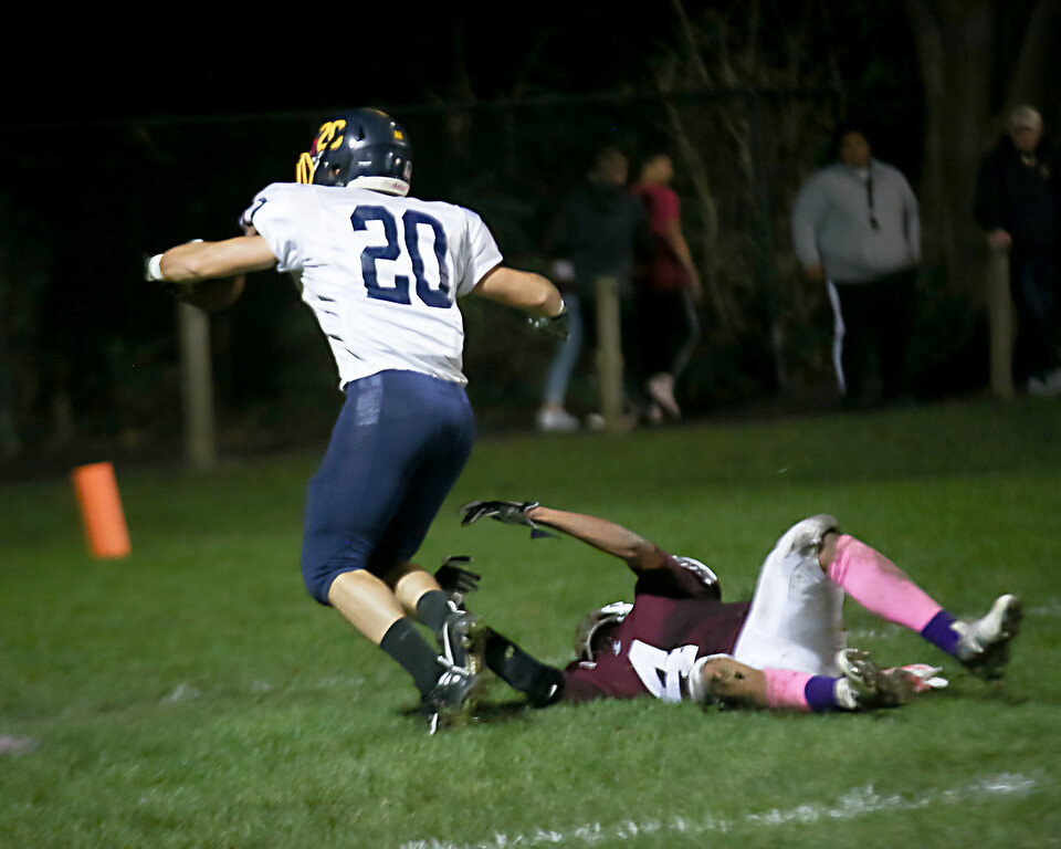 . Coleen Moskowitz - The News-Herald Fairport\'s Rashawn Alston tries to bring down Kirtland\'s Ryan Lipps, who scored a touchdown on Oct. 12.