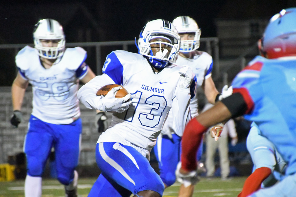 . Patrick Hopkins - The News-Herald Gilmour\'s C.J. Charleston carries against VASJ on Oct. 14 at Euclid.