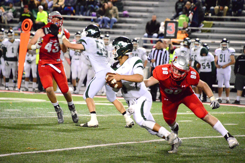 Brittany Chay - The News-Herald<br /> Mentor's Mark Gordon pursues the quarterback during Mentor's victory over visiting Strongsville on Oct. 13.