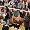 John P. Cleary |  The Herald Bulletin<br /> Alexandria's Mackenzie McCurty get a kill over the Monroe Central defender.
