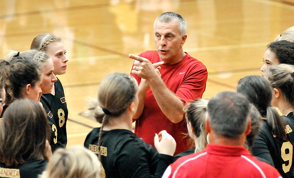 John P. Cleary    The Herald Bulletin<br /> Alexandria coach Jeff Harmon gives instructions during one of his timeouts in the third set.