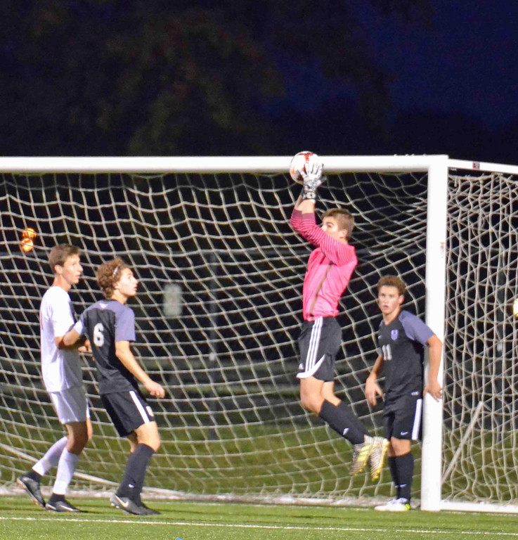 . Paul DiCicco - The News-Herald University School goalkeeper makes a great leaping save early in the first half of play at Mentor on Oct 14.