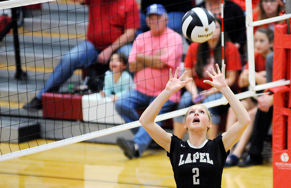 Don Knight | The Herald Bulletin<br /> Lapel's Isabel Anderson passes the ball as the Bulldogs faced the Wapahani Raiders in the sectional opener on Tuesday.