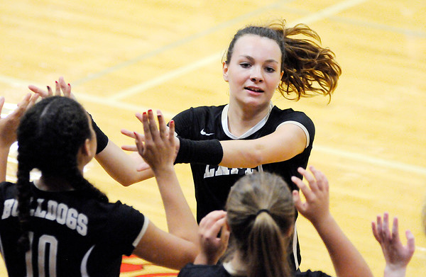 Don Knight | The Herald Bulletin<br /> Lapel's Jada Hans high fives her teammates as she subs out of the game against Wapahani during the sectional opener on Tuesday.