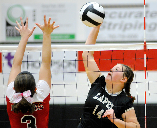 Don Knight | The Herald Bulletin<br /> Lapel's Emily Eppert attacks the ball as the Bulldogs faced the Wapahani Raiders in the sectional opener on Tuesday.