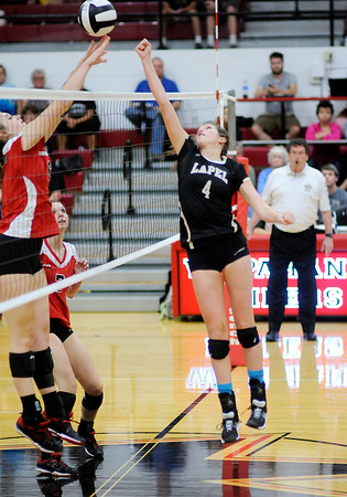 Don Knight | The Herald Bulletin<br /> Lapel's Riley Gill gets the ball past a Wapahani blocker as the Bulldogs faced the Raiders in the sectional opener on Tuesday.