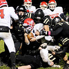 Don Knight | The Herald Bulletin<br /> Frankton's Landon Bouslog is tackled by a host of Bulldogs as Lapel hosted the Eagles in the first round of the sectional on Friday.
