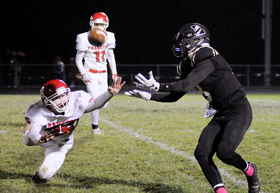 Don Knight | The Herald Bulletin Lapel's Connor Gill pulls in a pass from Cole Alexander as Frankton's Brayton Cain attempts to break up the play in the first round of the sectional on Friday.