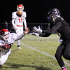Don Knight | The Herald Bulletin<br /> Lapel's Connor Gill pulls in a pass from Cole Alexander as Frankton's Brayton Cain attempts to break up the play in the first round of the sectional on Friday.