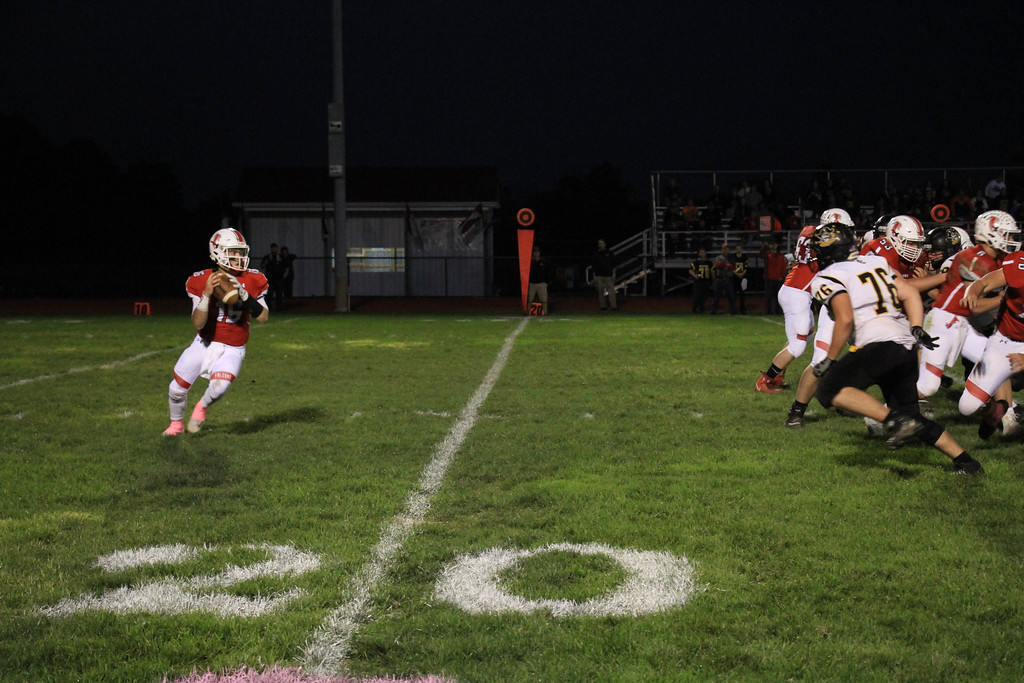 . Nicholas Pfeifer - The Morning Journal<br> Firelands quarterback Michael Bansek rolls to his right in search of a receiver down field against Black River on Oct. 20.