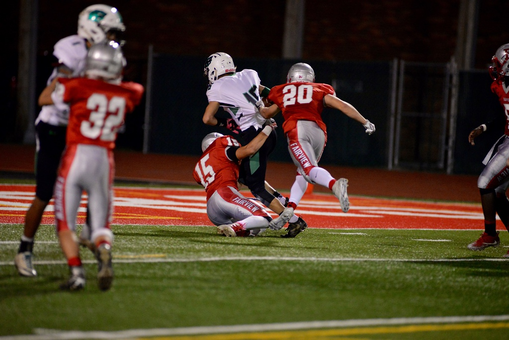 . Aimee Bielozer - The Morning Journal<br> Columbia\'s Jared Bycznski bulldozes his way into the end zone in spite of the tackle attempts by Fairview\'s Jack Provenza (15) and Marty Rehor on Oct. 20.