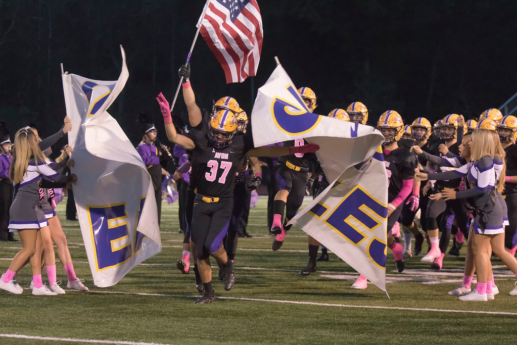 . Jen Forbus - The Morning Journal<br> Senior Alex Waters leads the Avon Eagles onto the field for their contest against the Amherst Comets on Oct. 20.