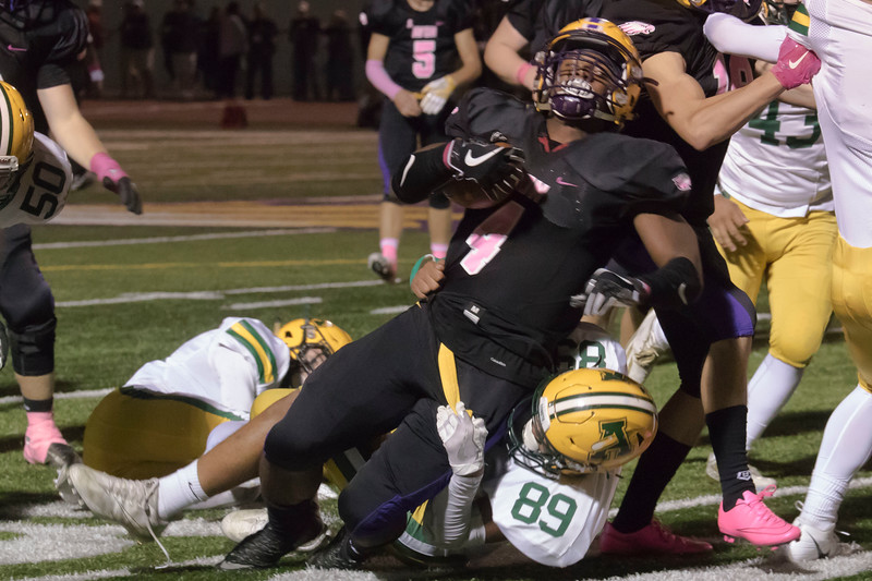 Jen Forbus - The Morning Journal<br>Amherst's Greg Rhodes (89) holds tight in an attempt to bring down Avon running back Tony Eberhardt (4) on Oct. 20.