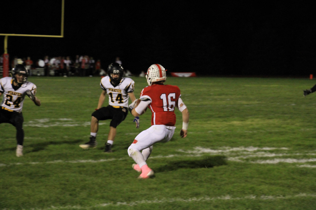 . Nicholas Pfeifer - The Morning Journal<br> Firelands\' quarterback Michael Bansek keeps it himself and looks to shake the Black River defenders on Oct. 20.