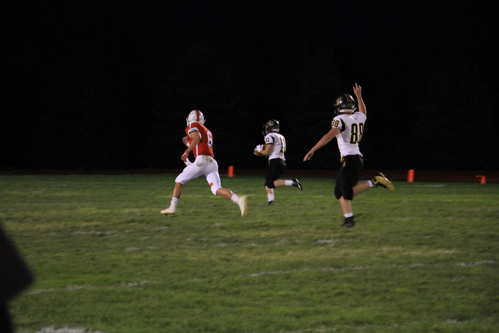 . Nicholas Pfeifer - The Morning Journal<br> Black River\'s Riley Gibbs hauls in a deep touchdown pass early in the first quarter against Firelands on Oct. 20.