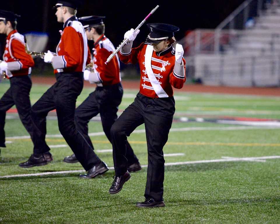 . Aimee Bielozer - The Morning Journal<br> A member of the Fairview marching band lets loose during halftime on Oct. 20.