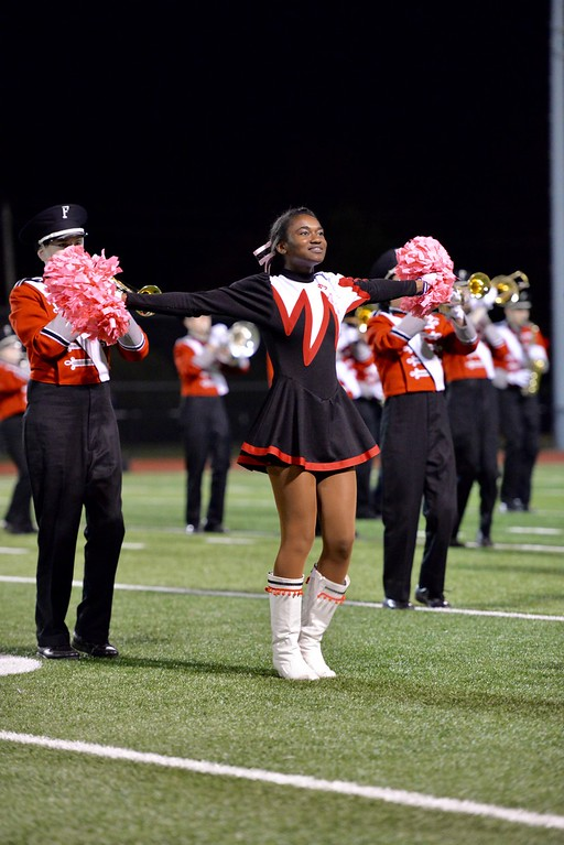 . Aimee Bielozer - The Morning Journal<br> A Fairview cheerleader helps the band at halftime.