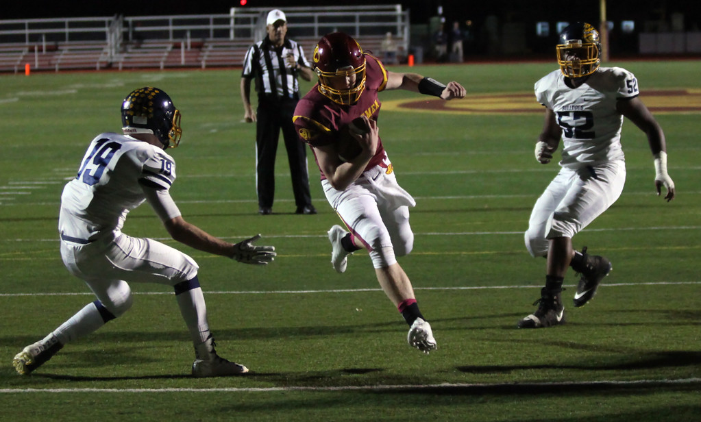 . Randy Meyers - The Morning Journal<br> Avon Lake quarterback Jack Mikolich runs through the Olmsted falls defense at the goal line for the game\'s first touchdown on Oct. 20.