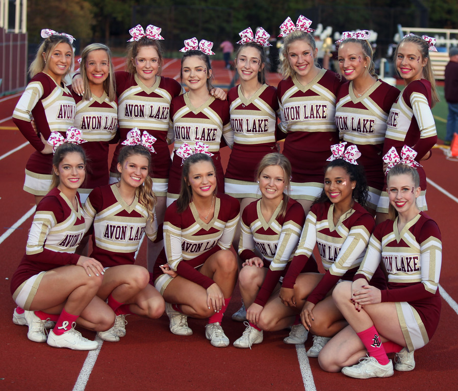 . Randy Meyers - The Morning Journal<br> The Avon Lake varsity cheerleaders pose for a photo prior to Friday\'s game against Olmsted Falls.