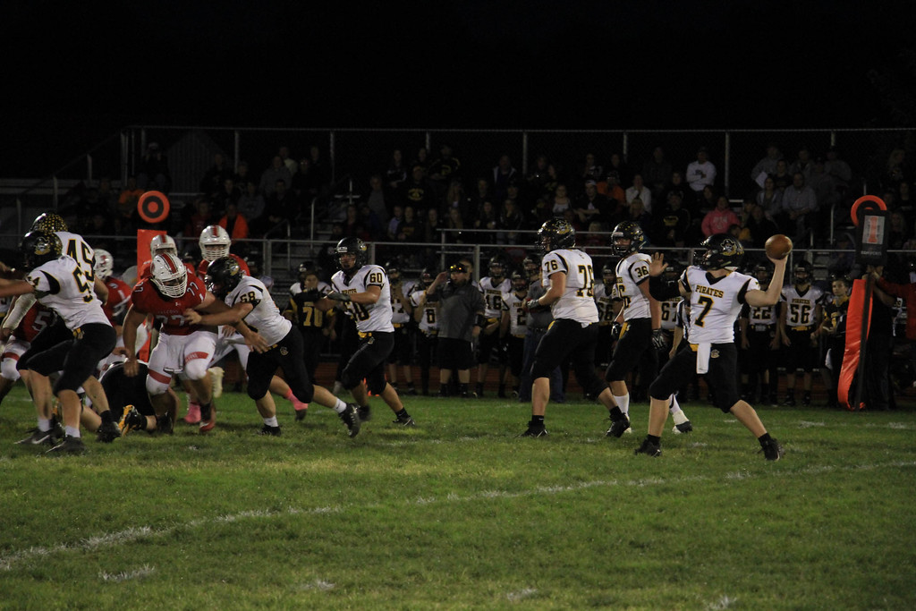 . Nicholas Pfeifer - The Morning Journal<br> Black River\'s quarterback Riley Bartolic drops back on the play action pass and delivers a deep strike for a Pirates touchdown against Firelands on Oct. 20.