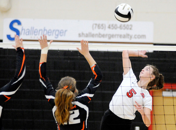 Don Knight | The Herald Bulletin<br /> Frankton's Kate Sperry attacks the ball as the Eagles faced the Wabash Apaches in the volleyball regional at Taylor High School on Saturday.