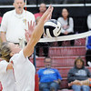 Don Knight | The Herald Bulletin<br /> Frankton's Audrey Cleek blocks a Wabash attack  in the volleyball regional at Taylor High School on Saturday.