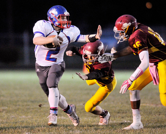 Don Knight | The Herald Bulletin<br /> Elwood's Jake Wilson tries to stiff arm Alexandria's Dylan Dowling as his pursued by Dowling and Evan Ogborn during the sectional opener on Friday.