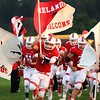Amanda K. Rundle - The Morning Journal<br /> Firelands senior Larry Verhovec (7) leads the Falcons onto the field on Sept. 23 as the Falcons prepared to play Oberlin.
