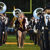 Eric Bonzar—The Morning Journal<br /> An Avon Lake majorette splits the Olmsted Falls Marching Band, Oct. 14, 2016.