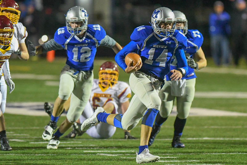 Eric Bonzar—The Morning Journal<br /> Midview's Dustin Crum (14) rushes into the end zone on a quarterback keeper, Oct. 21, 2016.