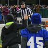 Eric Bonzar—The Morning Journal<br /> Back Judge Less Gregg, of North Ridgeville, tosses around the pigskin with the Midview ball boys, prior to the start of the Middies' Southwestern Conference game against the Avon Lake Shoremen, Oct. 21, 2016.