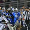 Eric Bonzar—The Morning Journal<br /> A pass intended for Midview's Keith Johnson (2) is broken up by Caleb Burr (16), Oct. 21, 2016. Burr was called for pass interference on the play.