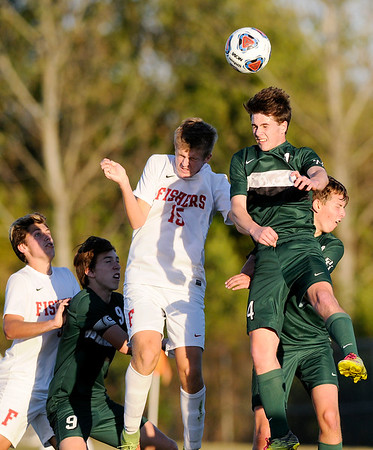 Don Knight | The Herald Bulletin<br /> Pendleton Heights' Andrew Oracheff heads the ball on a corner kick as the Arabians faced Fishers in the first round of the sectional at Noblesville on Monday.