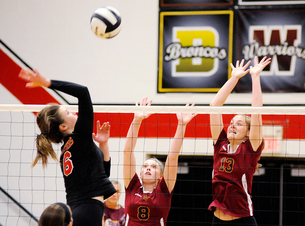 Don Knight | The Herald Bulletin<br /> Alexandria's Mary Kait Sayre (8) and Regan Lundy (13) block Wapahani's Estella Davis during regional action on Tuesday.