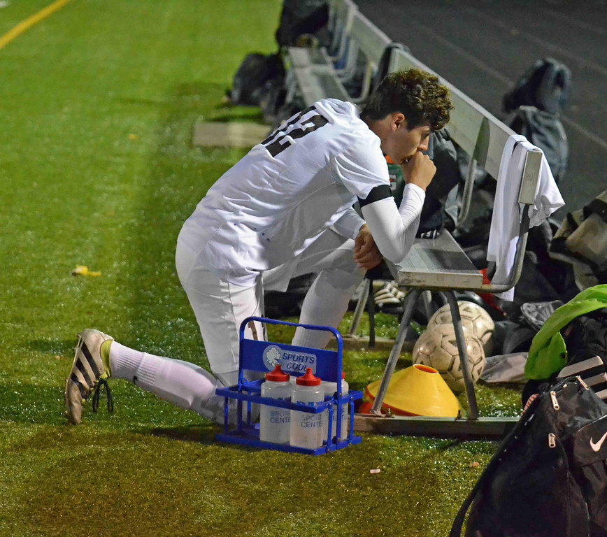 . Paul DiCicco - The News-Herald Brush Senior, Oliver Wenzler, pays tribute to his fallen teammate, Alec Kornet, as his teammates honor him by hanging his jersey on the bench and all touch it for good luck.
